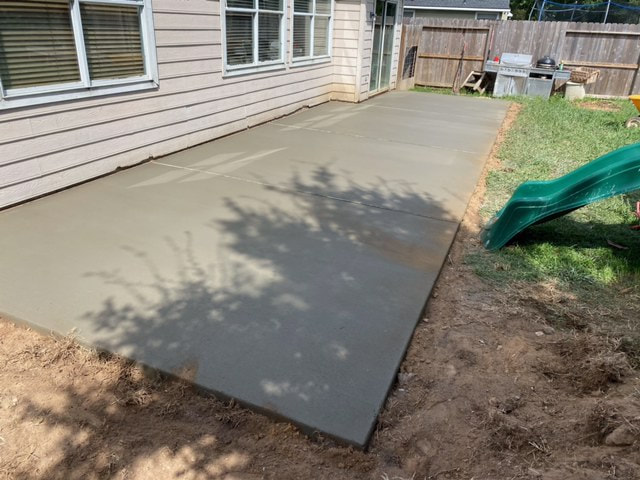 wide view of new concrete patio